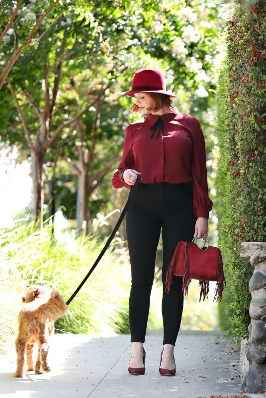 CHRISTINA HENDRICKS Out with Her Dog in Los Angeles 09/04/2018