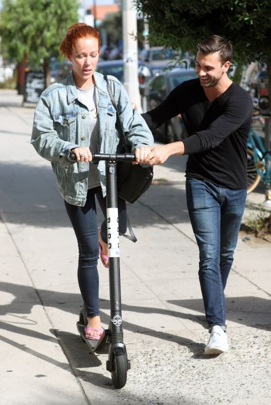 KENDRA WILKINSON Rides a Scooter Out in West Hollywood 09/21/2018