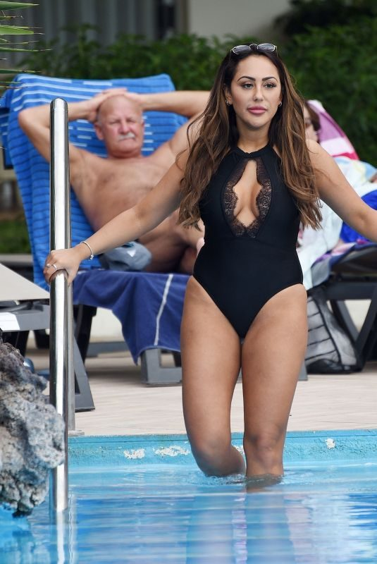 SOPHIE KASAEI in Swimsuit at a Pool in Tenerife 09/30/2018