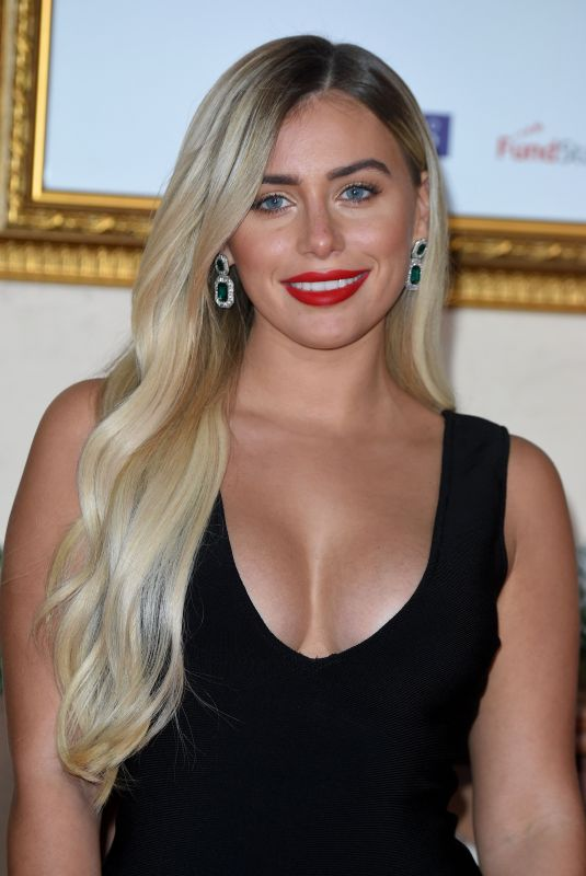ELLIE BROWN at Surviving Christmas with the Relatives Premeire in London 11/21/2018