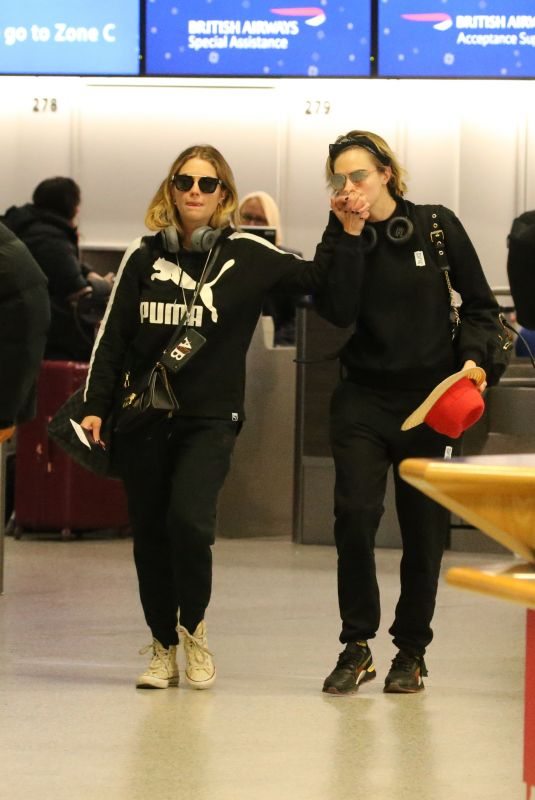ASHLEY BENSON and CARA DELEVINGNE at Gatwick Airport in London 12/21/2018