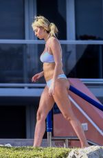 CORINNE OLYMPIOS in Bikini at a Pool in Miami 12/25/2018