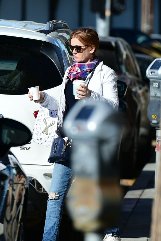 ISLA FISHER Leaves Alfred Coffee in Los Angeles 12/28/2018