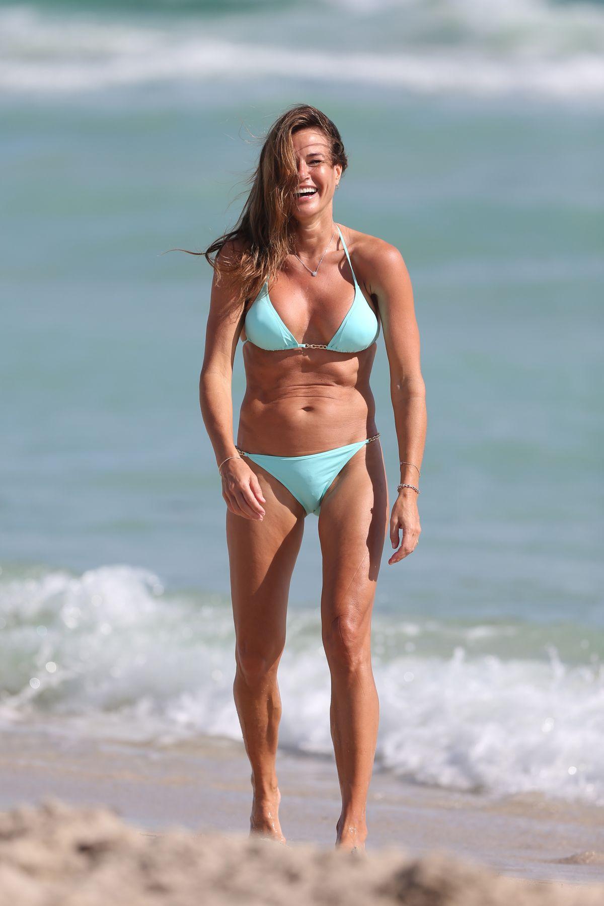 KELLY BENSIMON in Bikini at a Beach in Miami 12/31/2018