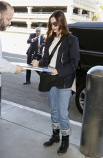 ANNE HATHAWAY at LAX Airport in Los Angeles 01/21/2019