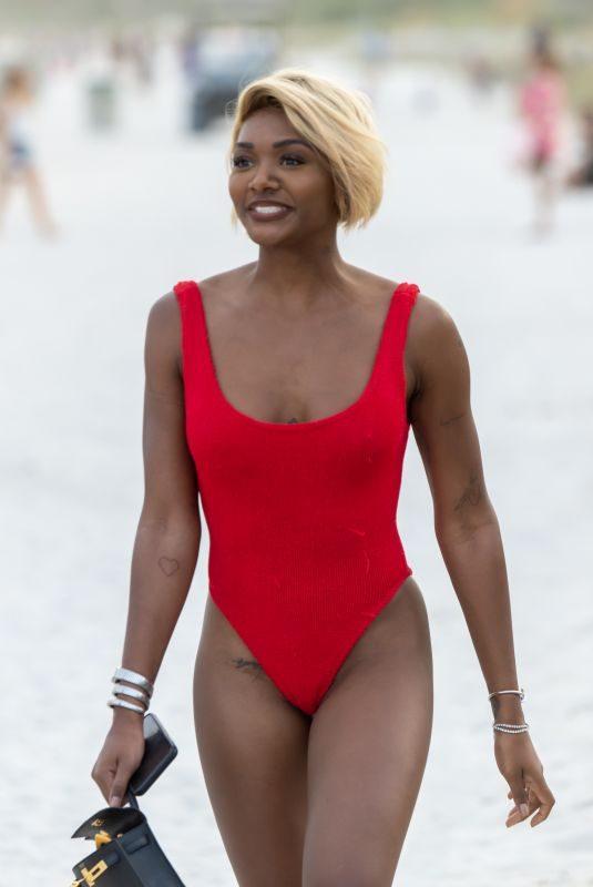 ELISA JOHNSON in Bikini at a Beach in Miami 01/01/2019
