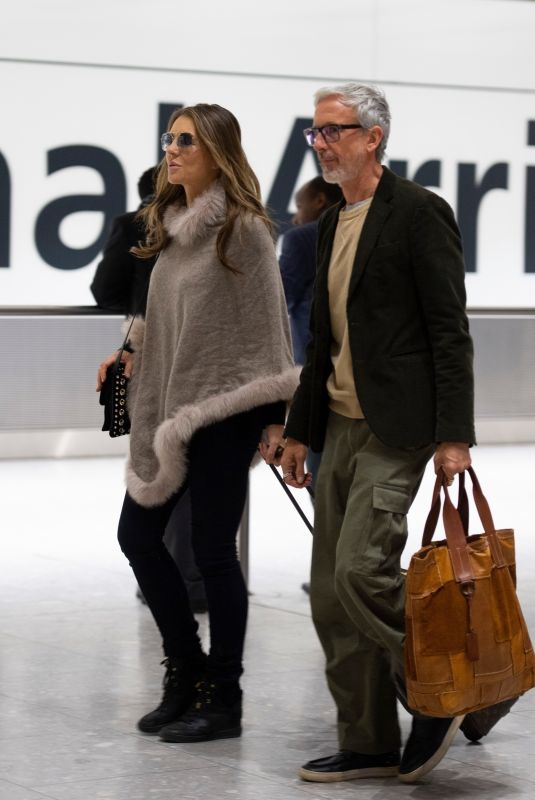 ELIZABETH HURLEY at Heathrow Airport in London 01/05/2019