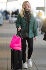 ELLE FANNING at JFK Airport in New York 01/07/2019