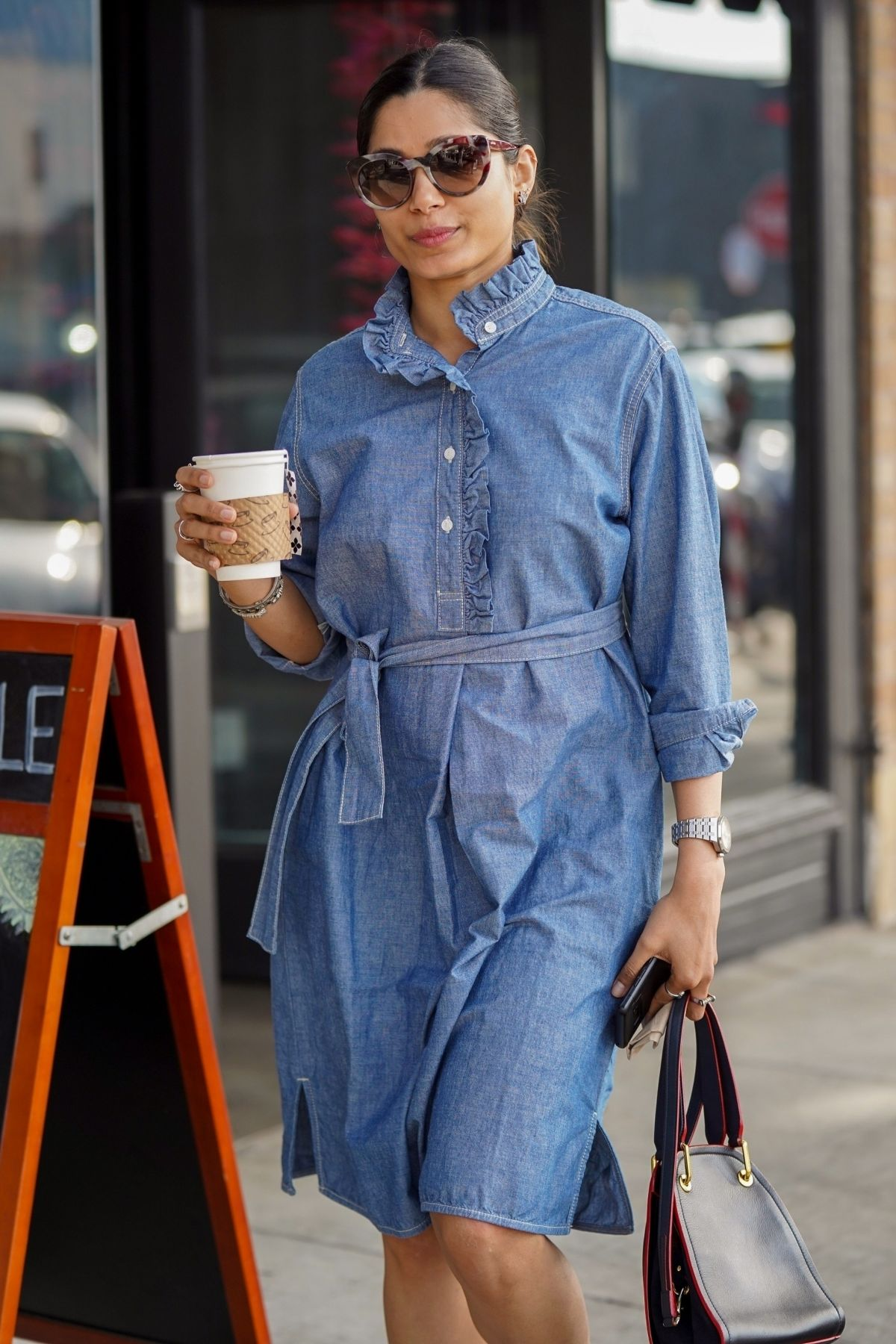 FREIDA PINTO in a Denim Dress Out in Los Angeles 01/11 ...