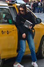 KATIE HOLMES Leaves a Taxi in New York 01/14/2019