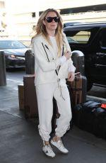 LEANN RIMES at Los Angeles International Airport 01/18/2019
