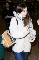LILY COLLINS at Salt Lake City Airport 01/25/2019