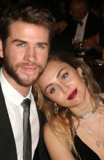 MILEY CYRUS and Liam Hemsworth at G
