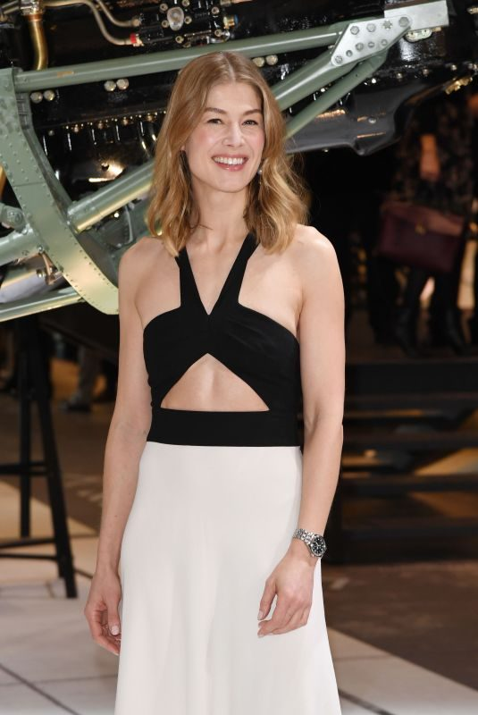 ROSAMUND PIKE at IWC Booth at Maison's Launch of Pilot's Watches at Sihh in Geneve 01/15/2019