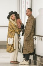 ASHLEE SIMPSON and Evan Ross at LAX Airport in Los Angeles 01/31/2019