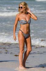ASHLEY JAMES in Bikini at a Beach in Tanzania 01/28/2019