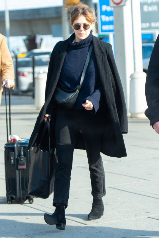 ELIZABETH OLSEN Arrivesa at JFK Airport in New York 02/15/2019