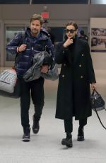 IRINA SHAYK and Bradley Cooper at JFK Airport in New York 02/07/2019