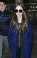 LILY COLLINS at Los Angeles International Airport 02/11/2019