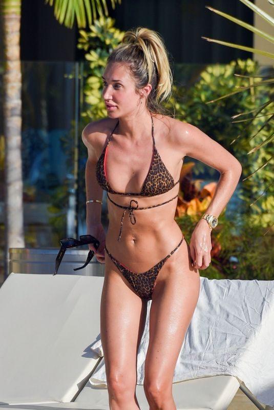 MEGAN MCKENNA in Bikini at a Pool in Tenerife 02/11/2019