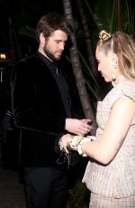 MILEY CYRUS and Liam Hemsworth at Charles Finch and Chanel
