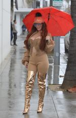 PHOEBE PRICE Out on a Rainy Day in Beverly Hills 02/15/2019