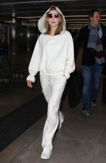 ROSAMUND PIKE Arrives at Airport in Milan 02/23/2019