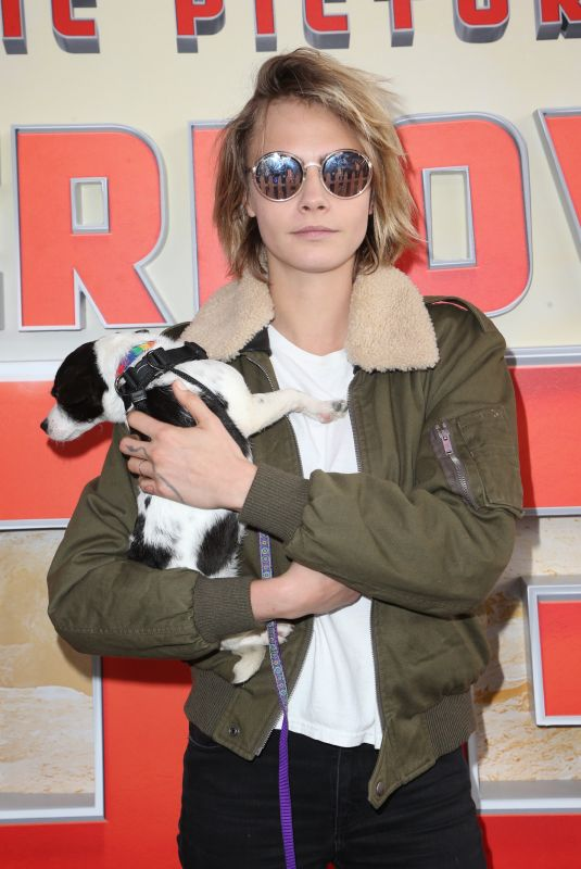 CARA DELEVINGNE at Superpower Dogs Premiere in Los Angeles 03/09/2019