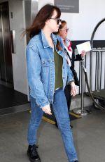 DAKOTA JOHNSON in Double Denim at LAX Airport in Los Angeles 03/01/2019