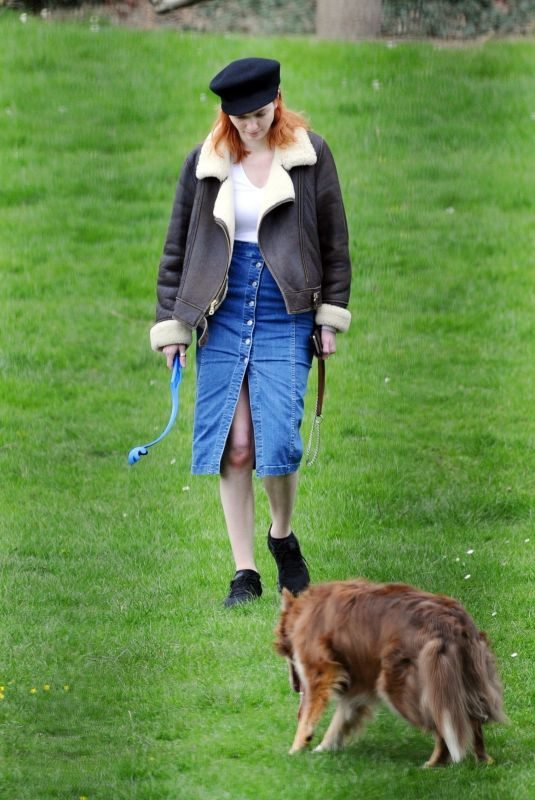 ELEANOR TOMLINSON with Her Dog at a Park in London 03/29/2019