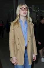 ELLE FANNING at Charles De Gaulle Airport in Paris 03/02/2019
