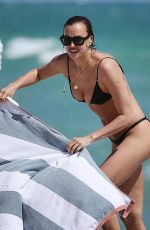 IRINA SHAYK in Bikini at a Beach in Miami 03/07/2019