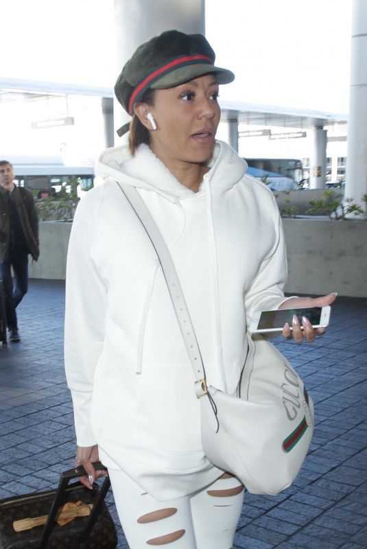MELANIE BROWN at Los Angeles International Airport 03/20/2019