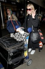 MICHELLE COLLINS at LAX Airport in Los Angeles 03/13/2019