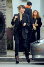 MILLA JOVOVICH Leaves Spago in Beverly Hills 03/07/2019