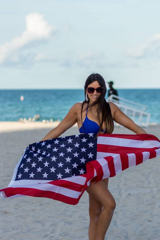 CLAUDIA ROMANI in Bikini in Front of American Flag in Miami 04/02/2019