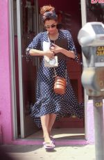 EVA MENDES in Polka Dot Dress Out in Los Angeles 04/26/2019