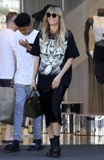 HEIDI KLUM Shopping at a Nike Store in Los Angeles 04/13/2019