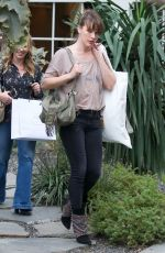 MILLA JOVOVICH Shopping at Isabel Marant in West Hollywood 04/04/2019