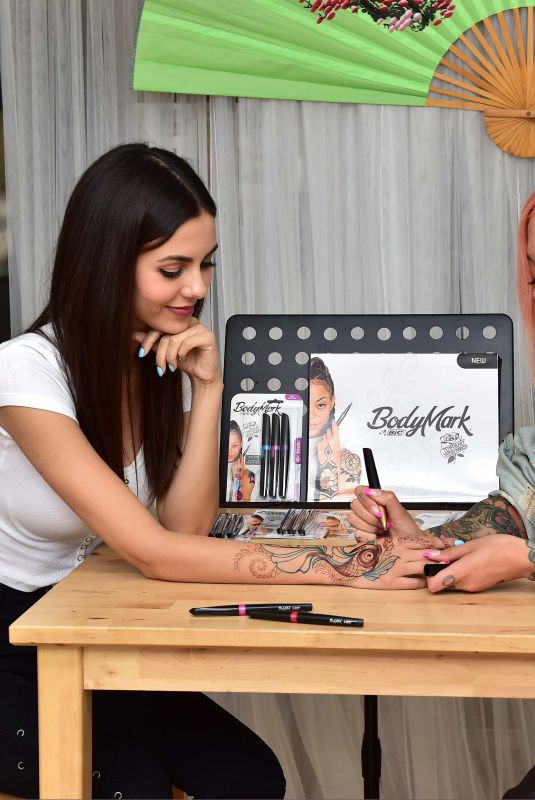 VICTORIA JUSTICE Getting a Temporary Tattoo from Miryam Lumpini in Los Angeles 04/09/2019