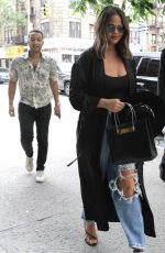 CHRISSY TEIGEN in Ripped Jeans Out and About in New York 05/29/2019