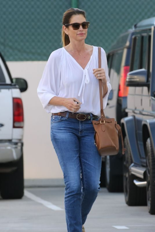 CINDY CRAWFORD in Denim Leaves a Beauty Salon in Beverly Hills 05/02/2019