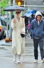 ELLE FANNING Out in the Rain in New York 05/05/2019