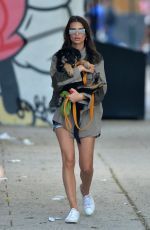 EMILY RATAJKOWSKI Carrying Her Dog Out in New York 05/24/2019