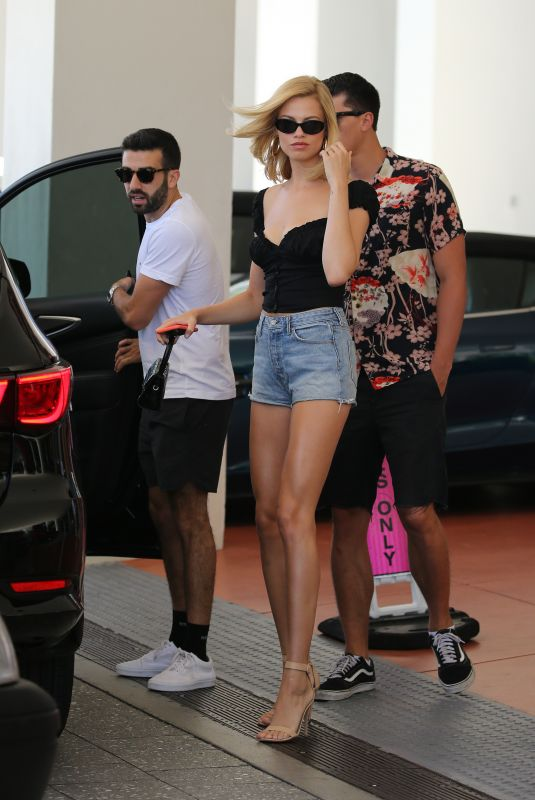 HAILEY CLAUSON in Denim Shorts Out in Miami 05/11/2019