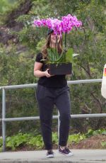 JENNIFER LOVE HEWITT Carries Some Flowers Out in Los Angeles 05/12/2019