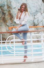 KIMBERLEY GARNER in Denim at Eden Roc Hotel in Cannes 05/24/2019