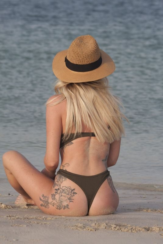 LAURA ANDERSON in Bikinis on the Beach in Dubai 05/12/2019