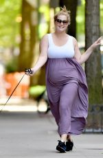 Pregnant AMY SCHUMER Out with Her Dog in New York 05/18/2019