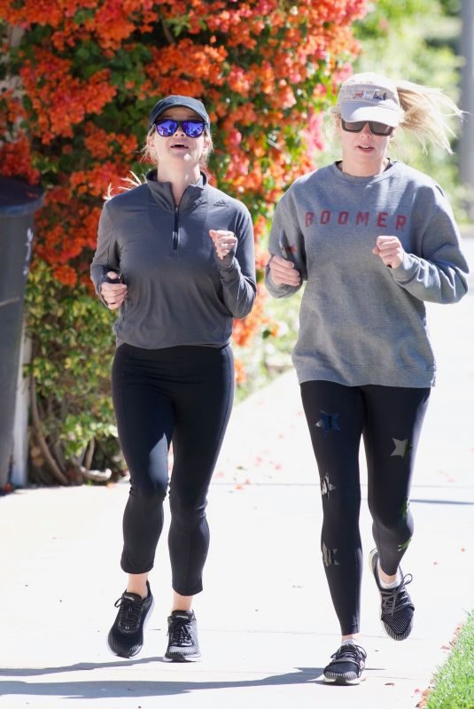 REESE WITHERSPOON Out Jogging with a Friend in Brentwood 05/27/2019